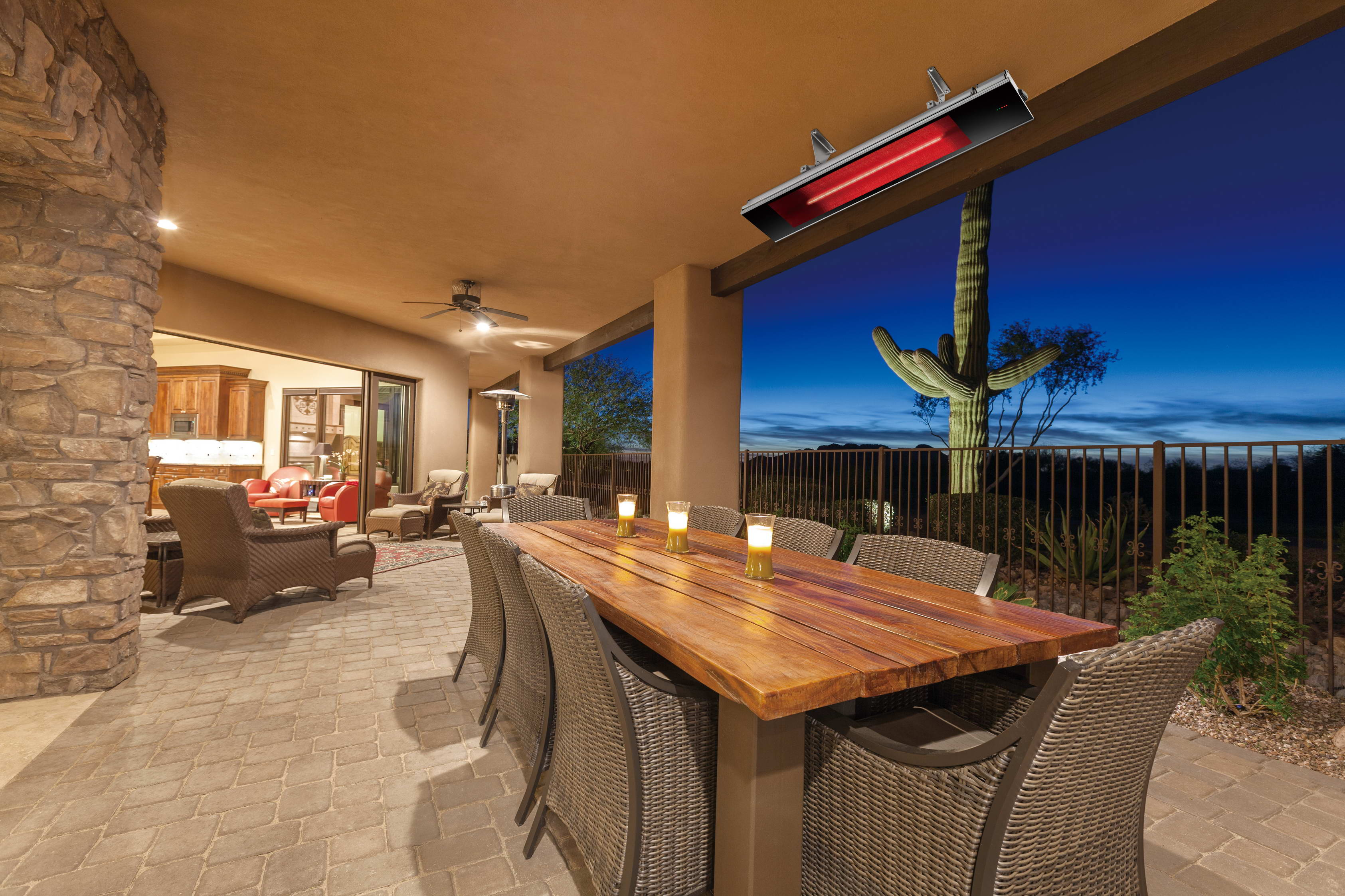 Luxury desert home patio with dining table after sunset.